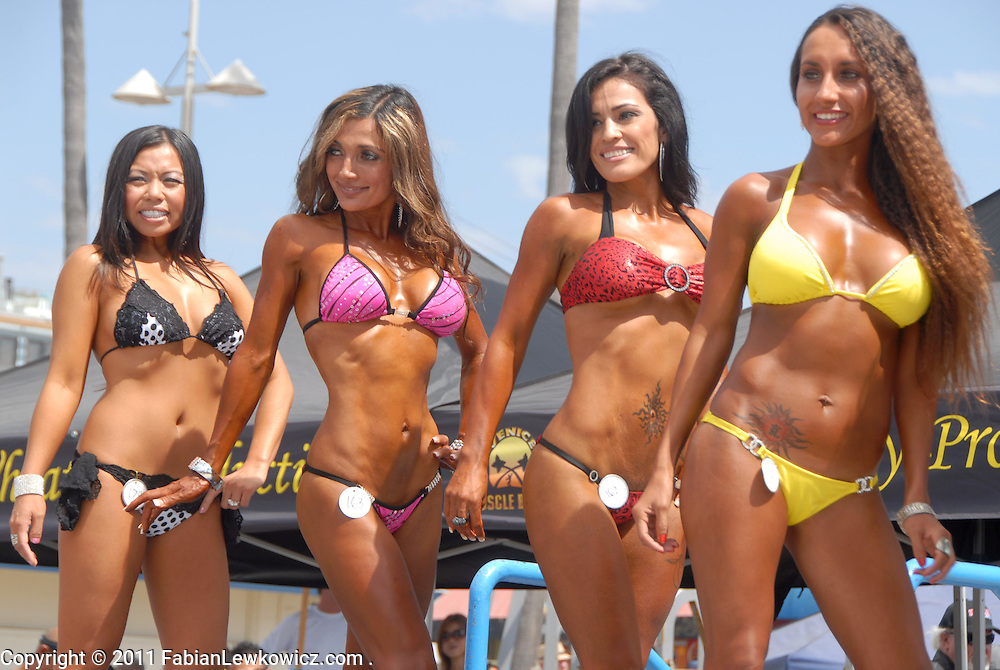 Women pose during the the Muscle Beach Bodybuilding championship at Venice Beach on Monday, September 5, 2011..Women pose during the the Muscle Beach Bodybuilding championship at Venice Beach on Monday, September 5, 2011..