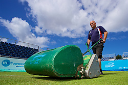 LIVERPOOL, ENGLAND - Thursday, June 15, 2017: Groundsman Terry Glover cuts the grass on centre court ahead of Day One of the Liverpool Hope University International Tennis Tournament 2017 at the Liverpool Cricket Club. (Pic by David Rawcliffe/Propaganda)