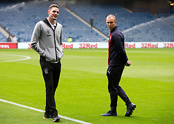 DundeeÕs Kenny Miller and Rangers Kyle Lafferty (left) prior to the Ladbrokes Scottish Premiership match at Ibrox, Glasgow.