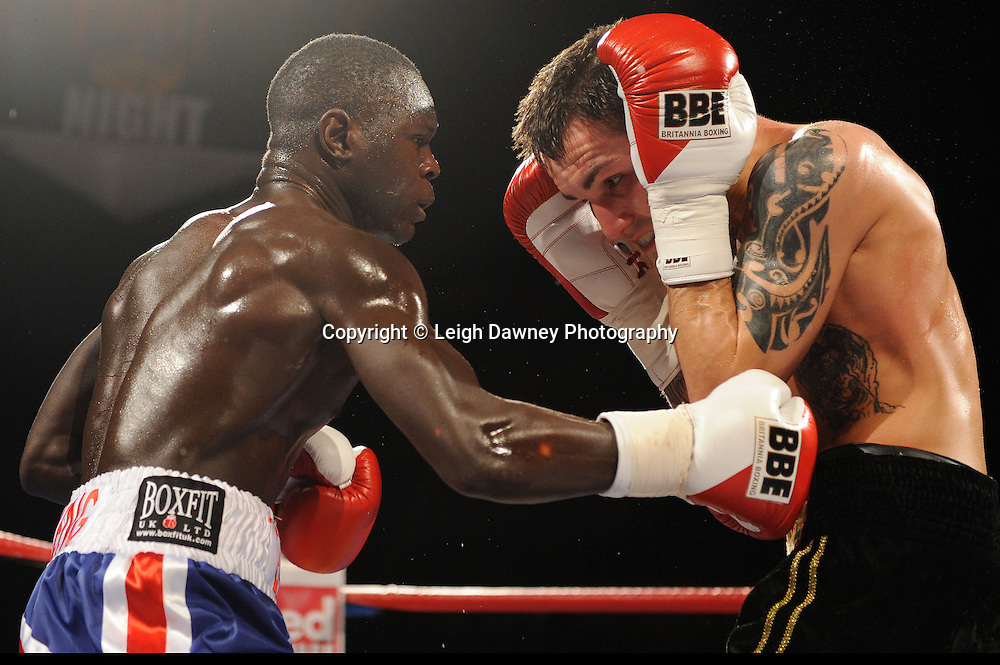 Erick Ochieng (Union Jack shorts) defeats Lee Noble at Brentwood Centre, Brentwood, Essex on the 5th February 2011. Frank Maloney Promotions. Photo credit © Leigh Dawney