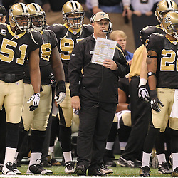 16 January 2010:  New Orleans Saints defensive coordinator Gregg Williams (center) watches from the sideline during a 45-14 win by the New Orleans Saints over the Arizona Cardinals in a 2010 NFC Divisional Playoff game at the Louisiana Superdome in New Orleans, Louisiana.
