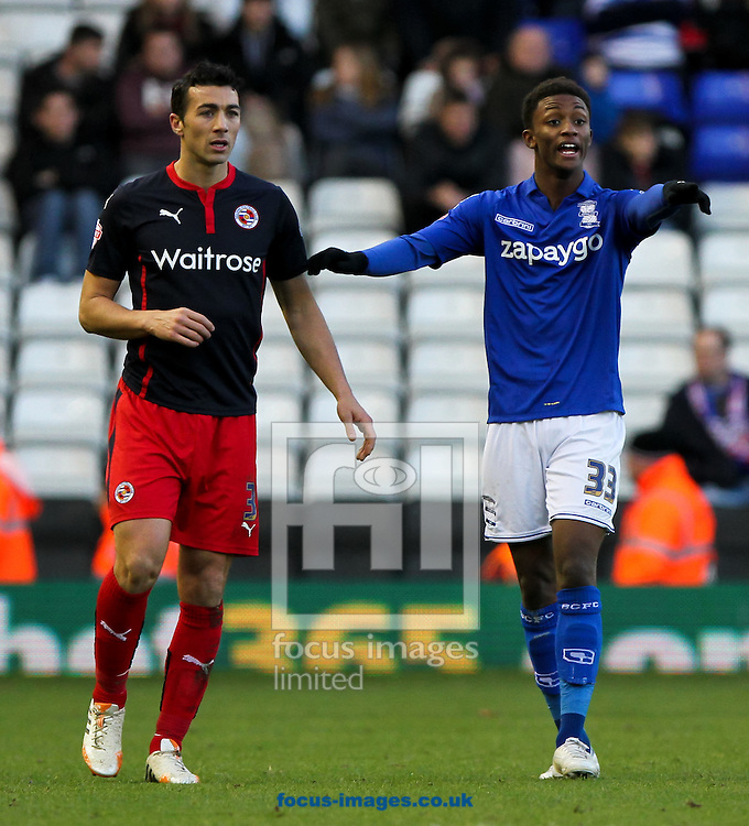 Demarai Gray (right) of Birmingham City and Stephen Kelly (left) of Reading during the Sky Bet Championship match at St Andrews, Birmingham<br /> Picture by Tom Smith/Focus Images Ltd 07545141164<br /> 13/12/2014