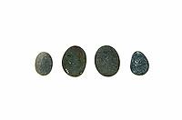 Four smooth, dark beach stones of Maine granite and schist.