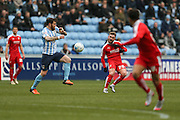 Swindon Town midfielder Anton Rodgers (26)  plays the ball through during the Sky Bet League 1 match between Coventry City and Swindon Town at the Ricoh Arena, Coventry, England on 19 March 2016. Photo by Simon Davies.