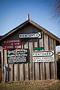 Old barn with signs at the Red Caboose Motel in Strasburg, PA.