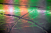10 April 2009: Colorful puddles of water in cracks on the ice in Anaheim, CA.