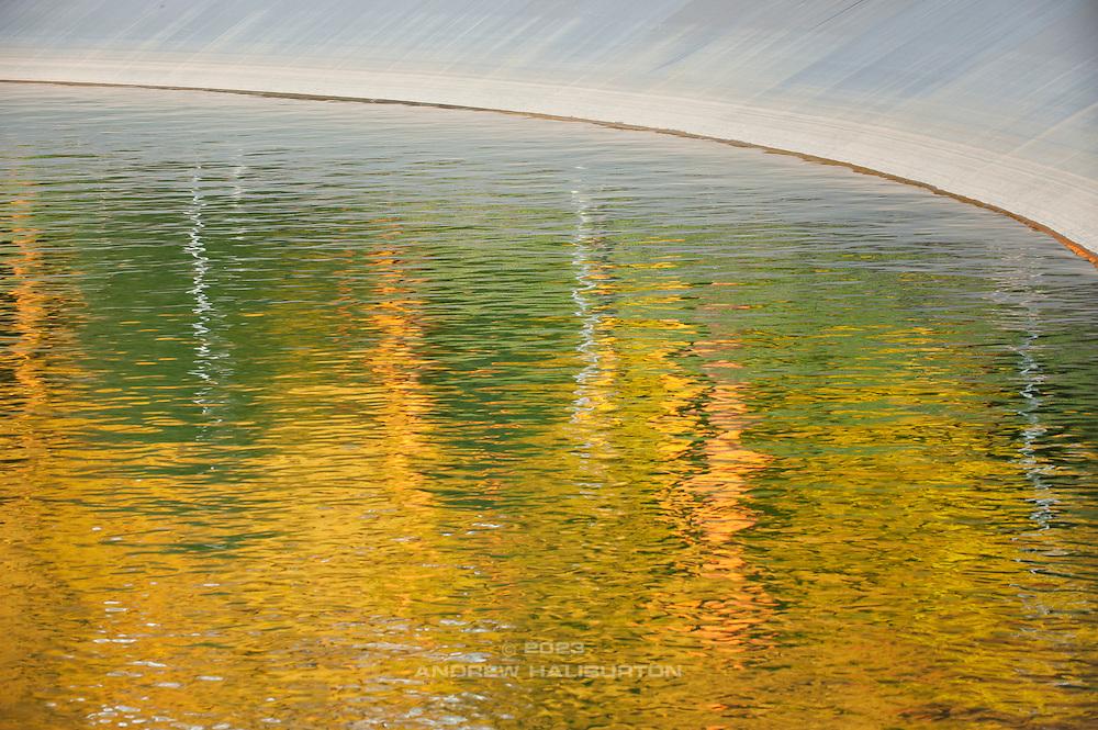 Autumn reflection on Reservoir 5, Mount Tabor Park Portland, Oregon, USA.