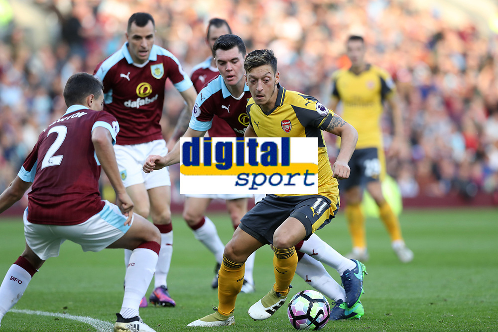 Football - 2016 / 2017 Premier League - Burnley v Arsenal at Turf Moor<br /> <br /> Mesut Ozil of Arsenal is surrounded by Burnley players <br /> <br /> <br /> COLORSPORT/LYNNE CAMERON