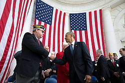 November 11, 2016 - Arlington, United States of America - U.S. President Barack Obama shakes the hand of Donald E. Larson, National President of the Fleet Reserve Association, after delivering remarks during Veterans Day at the Memorial Amphitheater in Arlington National Cemetery November 11, 2016 in Arlington, Virginia. (Credit Image: © Pete Souza/Planet Pix via ZUMA Wire)