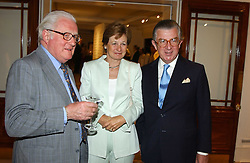 Left to right, VISCOUNT NORWICH and MR & MRS GEORGE MAGAN he is the leading City figure at auctioneers Sotheby's Summer party held at their showrooms in 34-35 New Bond Street, London W1 on 6th June 2005.<br /><br />NON EXCLUSIVE - WORLD RIGHTS