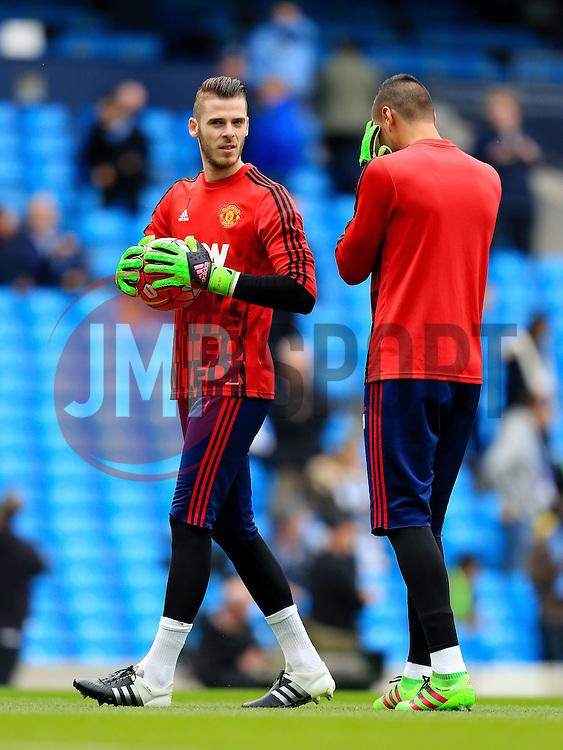 David de Gea of Manchester United warms up with Sergio Romero - Mandatory byline: Matt McNulty/JMP - 20/03/2016 - FOOTBALL - Etihad Stadium - Manchester, England - Manchester City v Manchester United - Barclays Premier League