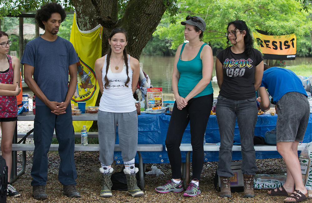Jessi Parfait speaking to group gathered at the openning day at L'eau Est La Vie Camp, in Southern Louisiana.
