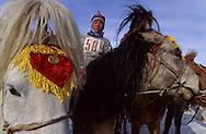Mongolia. horses race with kids. On the steppe with snow . Malah      Malah       /  course de chevaux pour enfants  sur la steppe enneigee  Malah  Mongolie course de chevaux pour enfants  sur la steppe enneigee  Malah  Mongolie course de chevaux pour enfants  sur la steppe enneigee  Malah  Mongolie v, les jeunes cavaliers portent un dossard et sont emmitoufles dans leur del car il fait -20°c   49       P0009461