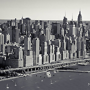 Over the Hudson River in a helicopter, a look toward Manhattan in black and white