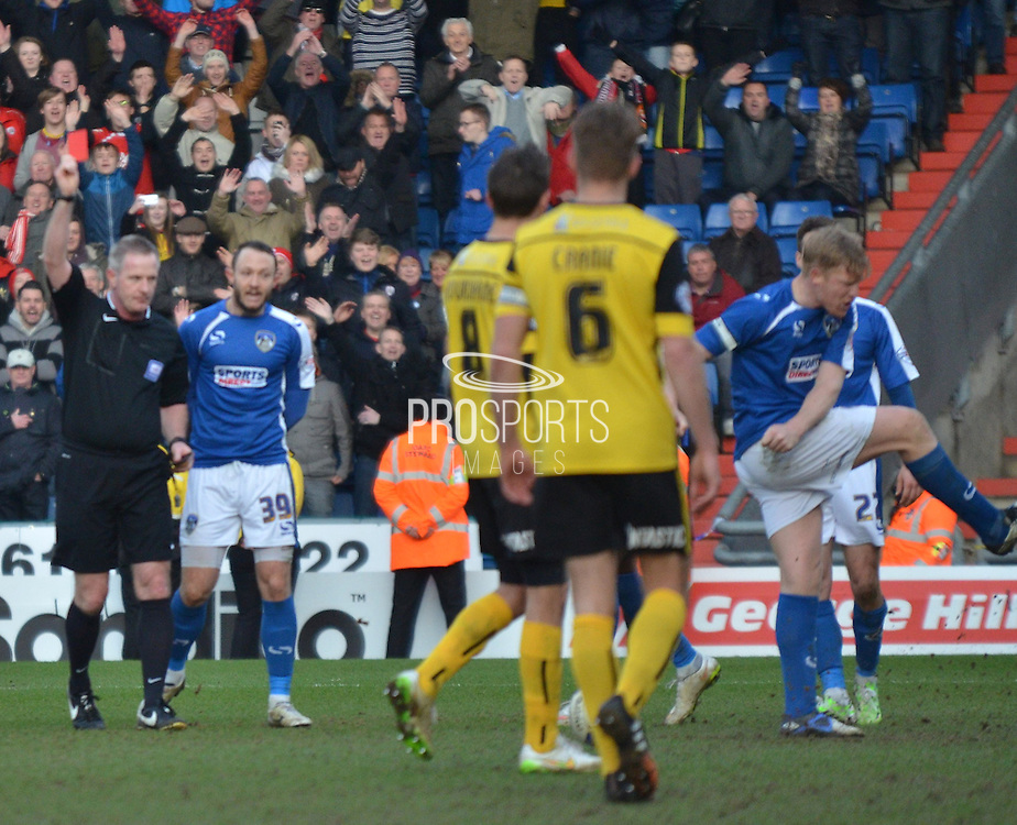 sending off for Luke Woodland during the Sky Bet League 1 match between Oldham Athletic and Barnsley at Boundary Park, Oldham, England on 14 March 2015. Photo by Mark Pollitt.