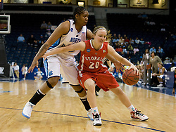 Georgia guard Angela Puleo (20) dribbles past North Carolina forward Erlana Larkins (2).  The #1 seed North Carolina Tar Heels defeated the Georgia Bulldogs 80-66 in the second round of the 2008 NCAA Women's Basketball Championship at the Ted Constant Convocation Center in Norfolk, VA on March 25, 2008.