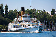 Old Paddle steamer ferry crosses Lac Leman, Lake Geneva, from Evian-les-Bains, France