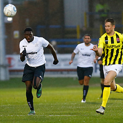 Dover's forward Inih Effiong and AFC Fylde's defender Neill Byrne both chase the ball during the National League match between Dover Athletic FC and AFC Flyde at Crabble Stadium, Kent on 08 December 2018. Photo by Matt Bristow.