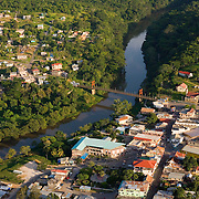 Aerial of houses, the Hawksworth Bridge and the Macal River in  San Ignacio Town, Belize
