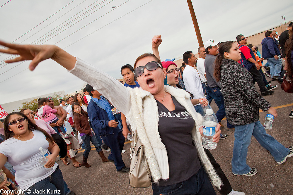 "16 JANUARY 2010 -- PHOENIX, AZ: Alicia Villalba (CQ) from Phoenix, jeers the sheriff during the march. About 10,000 people marched the 2.5 miles from Falcon Park to the ""Tent City"" on Durango to protest against Maricopa County Sheriff Joe Arpaio and his immigration enforcement tactics. PHOTO BY JACK KURTZ"