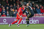 York City forward Vadaine Oliver  and Morecambe defender Ryan Edwards battle during the Sky Bet League 2 match between York City and Morecambe at Bootham Crescent, York, England on 19 December 2015. Photo by Simon Davies.