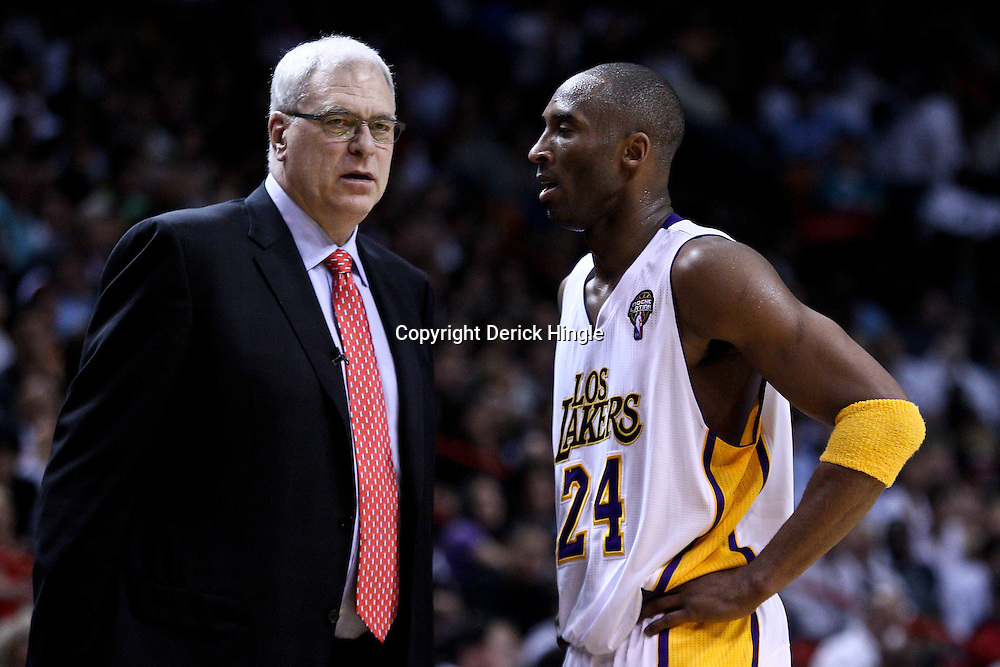 March 10, 2011; Miami, FL, USA; Los Angeles Lakers head coach Phil Jackson and shooting guard Kobe Bryant (24) talk during the second quarter against the Miami Heat at the American Airlines Arena.  Mandatory Credit: Derick E. Hingle