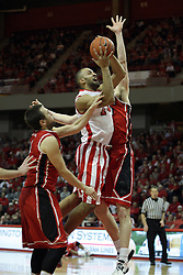13 February 2013:  Jackie Carmichael offers a shot while pinned between Jake Eastman and Will Egolf during an NCAA Missouri Valley Conference mens basketball game where the Bradley Braves were defeated by Illinois State Redbirds 79-59 in Redbird Arena, Normal IL
