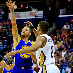Oct 28, 2016; New Orleans, LA, USA;  Golden State Warriors guard Stephen Curry (30) shoots over New Orleans Pelicans guard Tim Frazier (2) during the first quarter of a game at the Smoothie King Center. Mandatory Credit: Derick E. Hingle-USA TODAY Sports