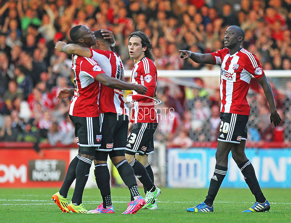Brentford's Andre Gray is congratulated after his equaliser during the Sky Bet Championship match between Brentford and Derby County at Griffin Park, London, England on 1 November 2014.