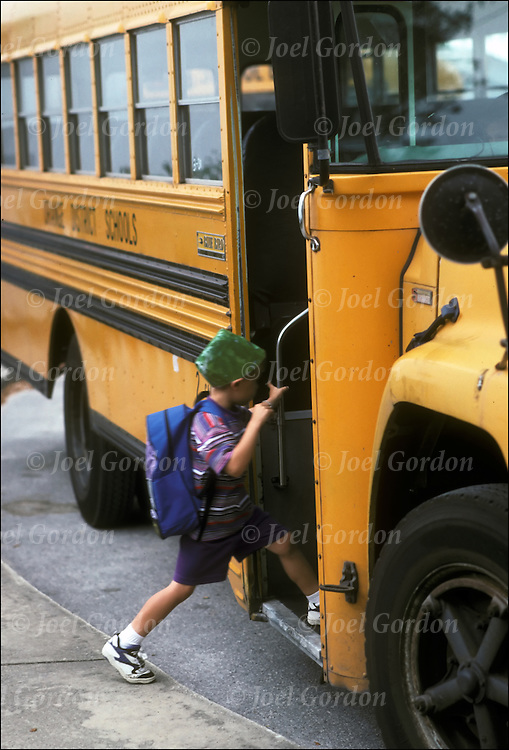 Young child setting into school bus