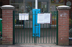 © Licensed to London News Pictures. 19/03/2018. London, UK. A sign on the gates of Cardinal Road School in Feltham, west London, asks parents to collect their children from a neighbouring school after it was evacuated following a bomb threat hoax. It is being reported a number of UK schools were emailed a hoax bomb threat this morning. Photo credit: Peter Macdiarmid/LNP