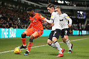 Millwall defender Mahlon Romeo holds up the ball during the EFL Sky Bet Championship match between Derby County and Millwall at the Pride Park, Derby, England on 20 February 2019.