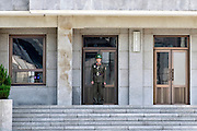 North Korean soldiers stand guard on the North side of the Military Demarcation Line (MDL) between North Korea and South Korea, inside the the demilitarized zone (DMZ) some 50 km north of Seoul, South Korea on 24 June 2010. .Photographer: Rob Gilhooly .