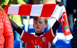 BANGOR, WALES - Monday, October 15, 2018: A young Wales supporter with his scarf held above his head during the UEFA Under-19 International Friendly match between Wales and Poland at the VSM Bangor Stadium. (Pic by Paul Greenwood/Propaganda)