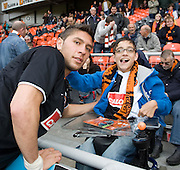 Andis Shala poses for a pic with a young fan - Dundee United v Hearts, Clydesdale Bank Scottish Premier League at Tannadice Park..© David Young Photo.5 Foundry Place.Monifieth.Angus.DD5 4BB.Tel: 07765252616.email: davidyoungphoto@gmail.com.http://www.davidyoungphoto.co.uk