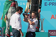 ALAN McNISH, Team Manager AUDI formula E - the Team trophy for best performance in the 2018 season has been handed to ALAN McNISH, Team Manager AUDI formula E - podium celebration with trophy by team AUDI SPORT - ABT Schaeffler, <br /> USA e-Prix, FIA Formula E, Formula E Grand Prix at the red hook Brooklyn New York harbor area on 15 July, 2018. Formel E in New York, Brooklyn, Red Hook port area. <br /> fee liable image, copyright@ ATP Arthur THILL