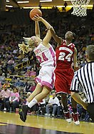 February 16 2011: Iowa Hawkeyes guard Jaime Printy (24) puts up a shot as Wisconsin Badgers guard Tiera Stephen (24) defends during the first half of an NCAA women's college basketball game at Carver-Hawkeye Arena in Iowa City, Iowa on February 16, 2011. Iowa defeated Wisconsin 59-44.