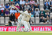 Sam Curran of England hits the ball over the boundary for six runs to bring up his half century during the first day of the 4th SpecSavers International Test Match 2018 match between England and India at the Ageas Bowl, Southampton, United Kingdom on 30 August 2018.
