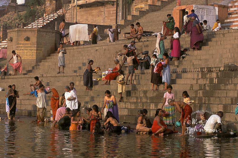 India, Uttar Pradesh, Varanasi, Ganges River, ghats & early morning bathers.