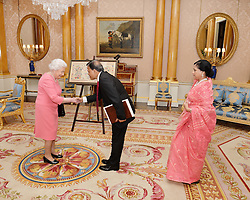 December 12, 2016 - London, London, United Kingdom - Image licensed to i-Images Picture Agency. 09/12/2016. London, United Kingdom. Queen Elizabeth II meets His Excellency Mr Md Nazmul Quaunine, the High Commissioner of Bangladesh, who was accompanied by his wife Mrs Quaunine, before he presents his Letters of Commission, at a private audience with Her Majesty  at Buckingham Palace in London .Picture by ROTA / i-Images  UK OUT FOR 28 DAYS (Credit Image: © Rota/i-Images via ZUMA Wire)