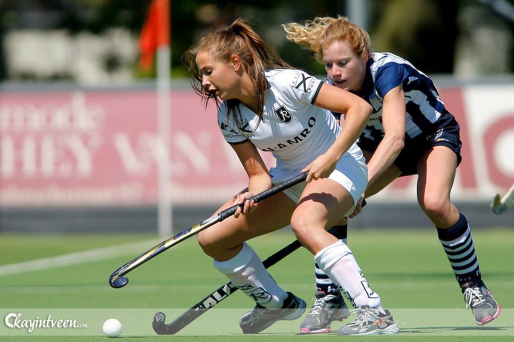 DEN HAAG - HDM - Rotterdam, Hoofdklasse hockey dames, seizoen 2010-2011, 01-05-2011, Lisa van Baaren (l) en Bernadette Wesdorp (r)