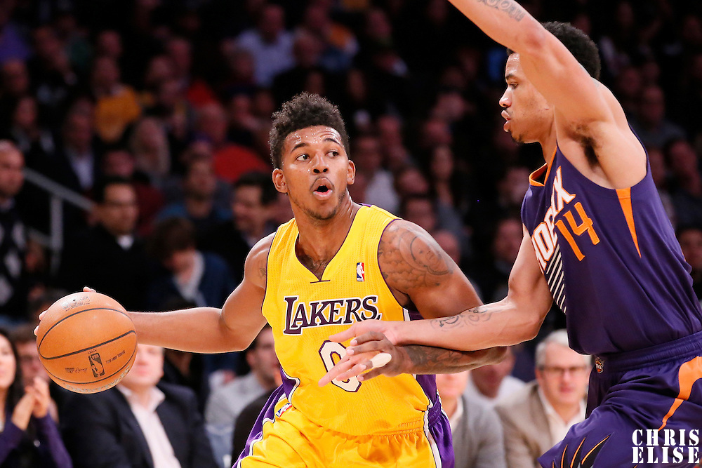 10 December 2013: Los Angeles Lakers small forward Nick Young (0) drives past Phoenix Suns shooting guard Gerald Green (14) during the Phoenix Suns 114-108 victory over the Los Angeles Lakers at the Staples Center, Los Angeles, California, USA.