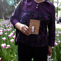BEIJING, MAY 6: a woman shows a description of her daughter in a park, Beijing, May 6,2007. ..Twice a week about 800 parents meet in the park trying to find suitable partners for their children. Similar activities are held throughout cities in China ...Due to heavy competition it's difficult for many young Chinese to find partners. This is true especially for women with high education levels like degrees from overseas  and PHDs.   Although customs are changing, there's a lot of pressure on young people to get married.     The children usually don't know of their parent's..activities.....