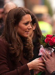 © Licensed to London News Pictures. 14/02/2012. Liverpool, UK. The Duchess of Cambridge holds bouquet of roses given to her by members of the public. Photo credit : Ashley Hugo/LNP