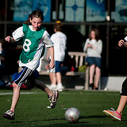June 2, 2010 - Bronx, NY : SAR hosted a charity soccer tournament at its lower school on June 2.  Sixth grader Dahlia Finther, left, of the New Zealand team faces off against Spain.