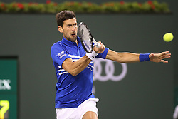 March 9, 2019 - Indian Wells, CA, U.S. - INDIAN WELLS, CA - MARCH 09: Novak Djokovic (SRB) hits a forehand during the BNP Paribas Open on March 9, 2019 at Indian Wells Tennis Garden in Indian Wells, CA. (Photo by George Walker/Icon Sportswire) (Credit Image: © George Walker/Icon SMI via ZUMA Press)