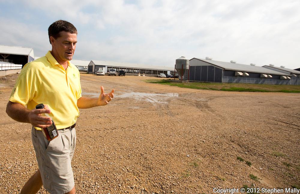 Tom Dittmer talks as he walks around Grandview Farms in Eldridge, Iowa on Thursday August 9, 2012.