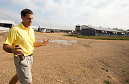 Tom Dittmer talks as he walks around Grandview Farms in Eldridge, Iowa on Thursday August 9, 2012.