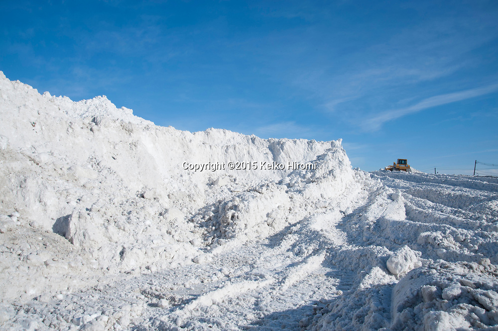 """February 6, 2015 Boston, MA USA:  Boston's largest """"Snow  farm"""" used to store snow in Seaport district in Boston, MA.  The snow is dumped here from all over the city. More than 60 inches of snow have fallen in Boston since Christmas."""