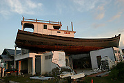 Boat on top of house. Banda Aceh. February 2006. Martine Perret